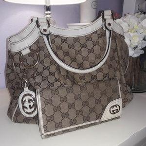 Authentic Gucci handbag and matching wallet
